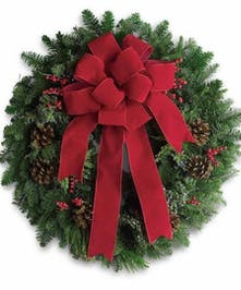 Fresh Holiday Wreath decorated in red