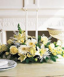 Oblong centerpiece with two white candles