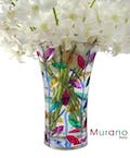 Vase with white orchids