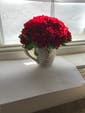 Shown with Carnations